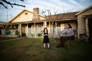 Jovita Torres, right, who has lived in the house she rents in Tombstone Territory for 30 years, in her garden with her three-year-old granddaughter Alessandra. Photograph: Talia Herman/The Guardian