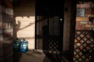 Bottled water on a front porch in Tombstone Territory, an unincorporated working-class area. Photograph: Talia Herman/The Guardian